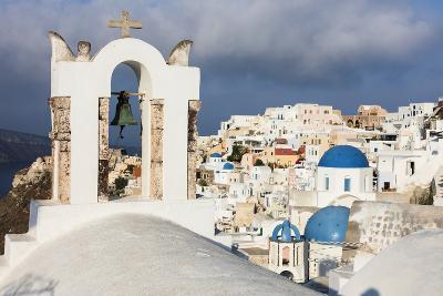 The White of the Church and Houses and the Blue of Aegean Sea as Symbols of Greece, Oia, Santorini-Roberto Moiola-Photographic Print