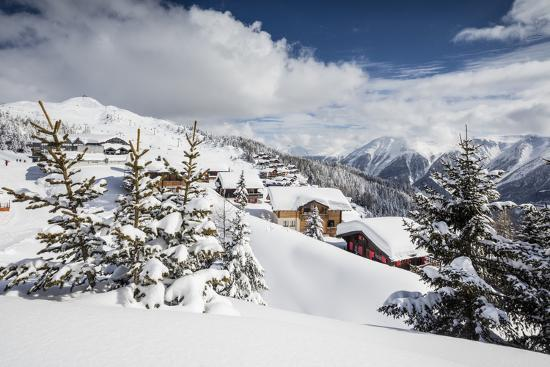 The Winter Sun Shines on the Snowy Mountain Huts and Woods, Bettmeralp, District of Raron-Roberto Moiola-Photographic Print