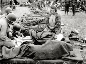 The Wounded are under Blankets and on Stretchers, Carentan, Normandy, France, June 1944