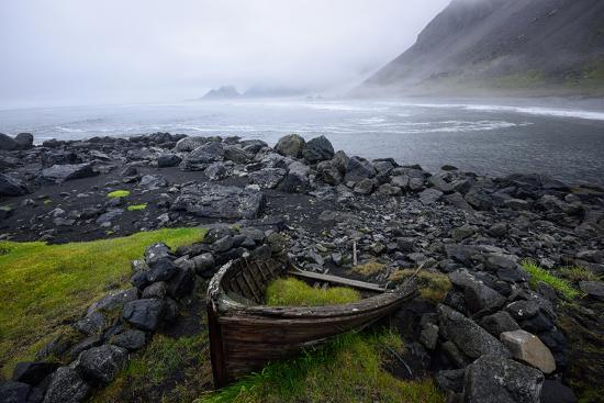The Wreck of a Boat Rests on Stokeness Beach in Hofn, Iceland-Keith Ladzinski-Photographic Print