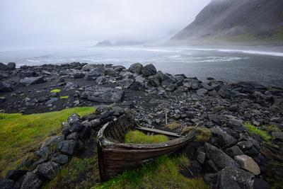 https://imgc.artprintimages.com/img/print/the-wreck-of-a-boat-rests-on-stokeness-beach-in-hofn-iceland_u-l-q12wtdv0.jpg?p=0