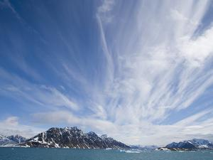 Cirrus Clouds Over Fjord in June by Theo Allofs