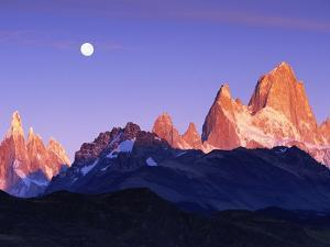 Moon Over Mount Torre and Mount Fitz Roy Peaks by Theo Allofs