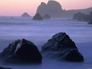 USA, California, Redwood National Park, Rocky shore with surf, dusk by Theo Allofs