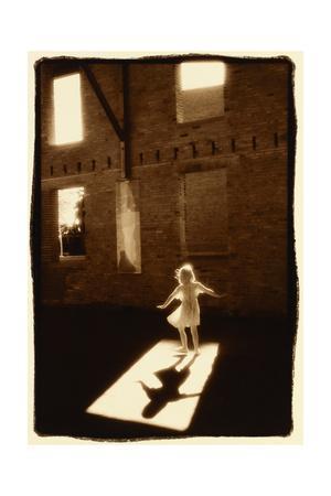 Girl dancing in a shaft of light