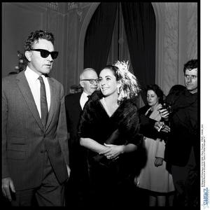 Elizabeth Taylor and Her Husband Richard Burton at a Party by Therese Begoin
