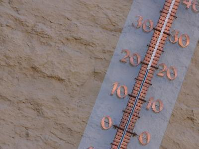 Thermometer Attached to a Stucco Wall--Photographic Print