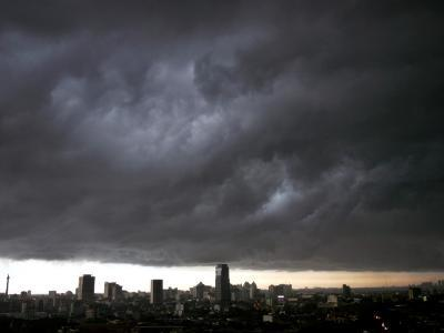 Thick Dark Cloud Hangs over Jakarta, Indonesia, before a Thunder Storm--Photographic Print