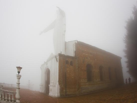 Thick Fog Engulfing the Santuario De Guadalupe Christ Statue-Mike Theiss-Photographic Print