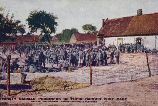 Thirsty German Prisoners in their Barbed Wire Cage, World War I--Photographic Print