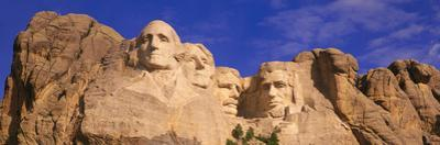 This Is a Close Up View of Mount Rushmore National Monument Against a Blue Sky