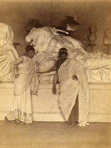 Two students in Grecian Costume before a plaster cast of the three fates from the Elgin Marbles by Thomas Cowperthwait Eakins