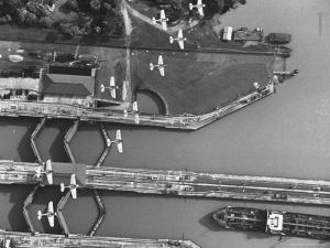 Aerial View of Planes Flying over the Panama Canal by Thomas D. Mcavoy