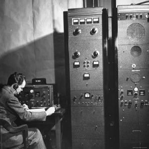 Agent of the FBI Listening to a Message Being Transferred Via Radio by Thomas D. Mcavoy