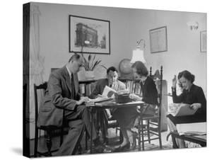 Alexander Szasz and Aladar Szegedy-Maszak Working at Crowded Table by Thomas D. Mcavoy