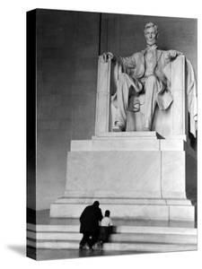 Black Man and Small Boy Kneeling Prayerfully on Steps on Front of Statue in the Lincoln Memorial by Thomas D. Mcavoy