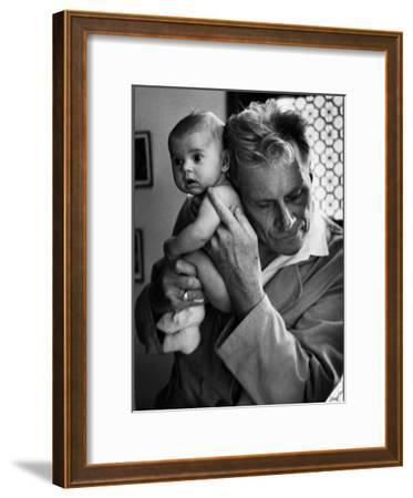 Blind Doctor Albert A. Nast Holding Ear to Back of 3 Month Old Instead of Using a Stethoscope
