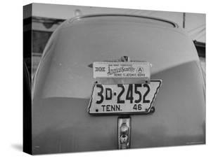Close Up of Tennessee License Plate with Special Civic Booster Attached by Thomas D. Mcavoy