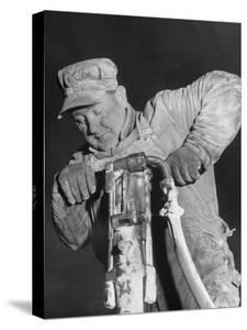 Construction Worker Using Jackhammer During Building of the Pennsylvania Turnpike by Thomas D. Mcavoy