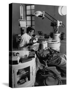 Dentist Filling Tooth of Patient in New 400 Bed Hospital That the Sheikh Built with His Oil Money by Thomas D. Mcavoy