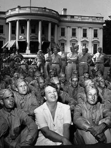 First Lady Eleanor Roosevelt with a Large Group of US Soldiers by Thomas D. Mcavoy
