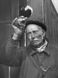 French Man Looking at How Clear the Wine Is by Thomas D. Mcavoy