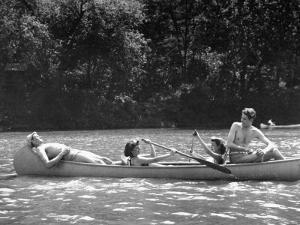 Friends Enjoying Themselves on Their Canoe Trip in the Potomac River by Thomas D. Mcavoy