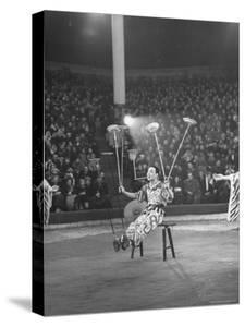 Juggler Spinning Seven Plates at Once by Thomas D. Mcavoy