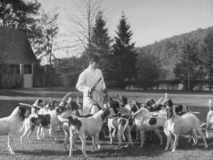 Man Standing with Group of Hounds at Rolling Rock Fox Hunt by Thomas D. Mcavoy