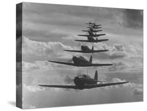 Nine Army Air Corps Bi-Place Pursuit Planes Flying in Formation with a Maximum Speed of 300 M.P.H by Thomas D. Mcavoy