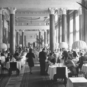 People Dining in the Hotel Dining Room by Thomas D. Mcavoy