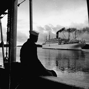 """Sailor Watching Us Army Troop Ship """"Republic"""" Passing Through the Panama Canal by Thomas D. Mcavoy"""