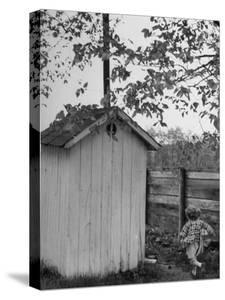 Small Child Running to the Outhouse at Rural School by Thomas D. Mcavoy