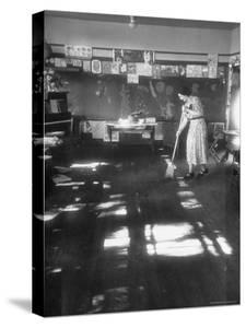Teacher stays behind to give school final sweeping on the last day after everyone has gone home by Thomas D. Mcavoy