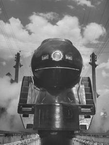 The Front End of a Streamlined Locomotive Sitting in Shaffer's Crossing Yard by Thomas D. Mcavoy
