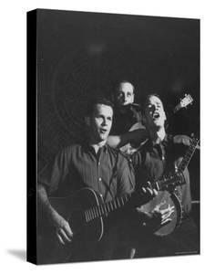 The Kingston Trio Performing on Stage by Thomas D. Mcavoy