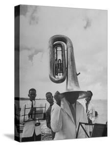 Tuba Player Keeping His Head Dry in a Rainstorm During Visit to St. Croix by Pres. Harry S. Truman by Thomas D. Mcavoy