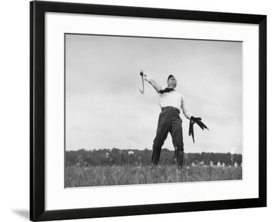 Vice Presidential Candidate Henry A. Wallace, Throwing a Boomerang in a Field
