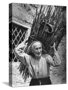 View of a Man Carrying a Big Bundle of Sticks from a Story Concerning Italy by Thomas D. Mcavoy