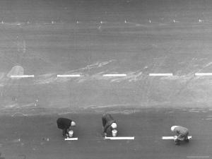 Women Painting White Traffic Lines by Thomas D. Mcavoy