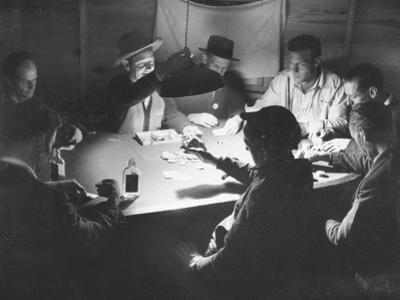 Workers on the Fort Blanding Site Playing a Game of Poker by Thomas D. Mcavoy