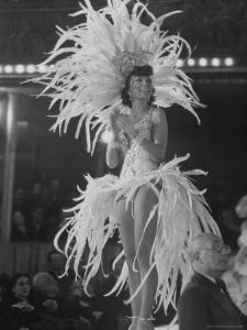 Yvonne Menard Standing on Glass Runway as Master of Ceremonies by Thomas D. Mcavoy