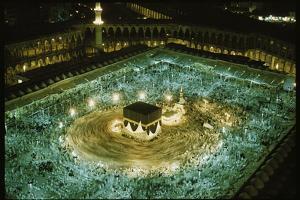Thousands of pilgrims circle the Kaaba. by Thomas J^ Abercrombie