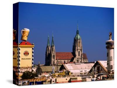 Beer Tents at Oktoberfest with Cathedral in the Background, Munich, Bavaria, Germany