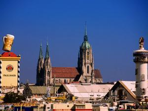 Beer Tents at Oktoberfest with Cathedral in the Background, Munich, Bavaria, Germany by Thomas Winz