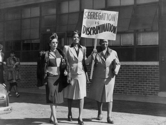 Three African American Women with Sign Reading, 'Segregation Is Discrimination'--Photo