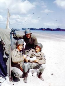 Three American Soldiers from the 1st Engineer Special Brigade Looking at Photos from Home