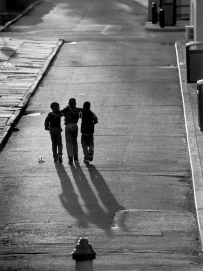 Three Boys Walking Down Street Arm in Arm-Len Rubenstein-Photographic Print