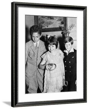 Three Children Standing Together Playing a Game--Framed Photo