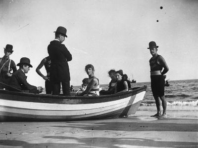 Three Girls Competing in a Swimming Match sit in boat before the meet at Coney Island, Brooklyn, NY-Wallace G^ Levison-Photographic Print